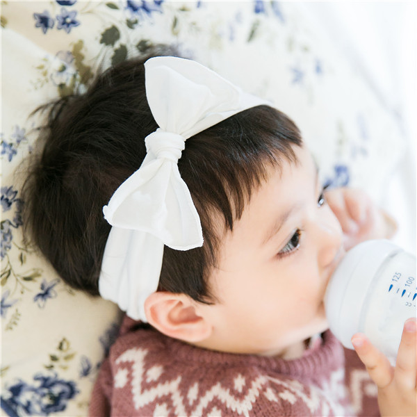 Color classification: White ruffled headband