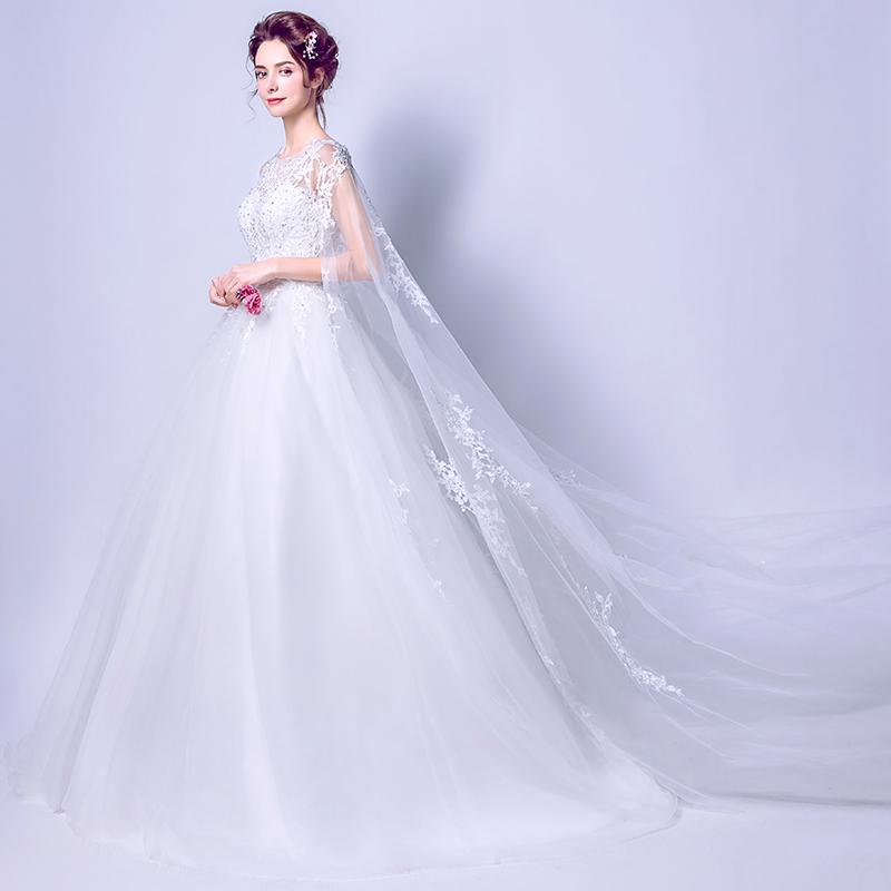 婚纱2018新款一字肩齐地简约旅拍公主梦幻拖尾婚纱披纱轻婚纱森系
