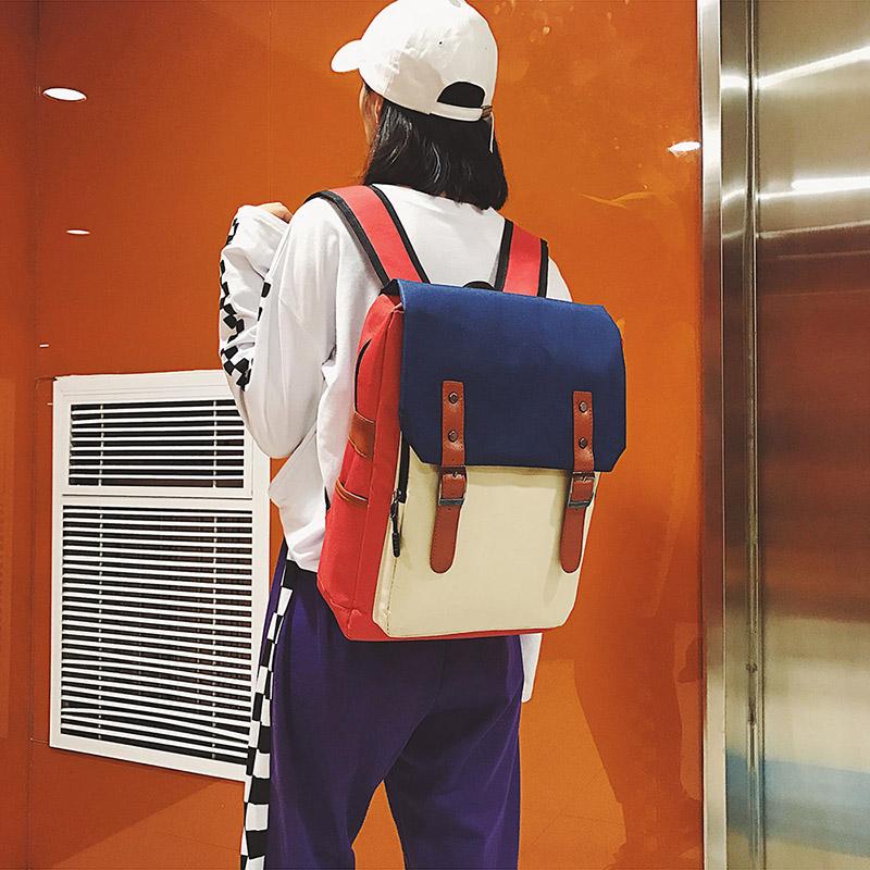 2018学院风撞色双肩包韩版学生女拼接书包大容量翻盖电脑包背包