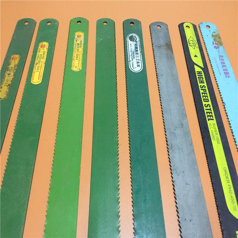 High speed machine hacksaw blade in front of old goods just W9 off the saw cutting iron shipping W5W18 planer cutter