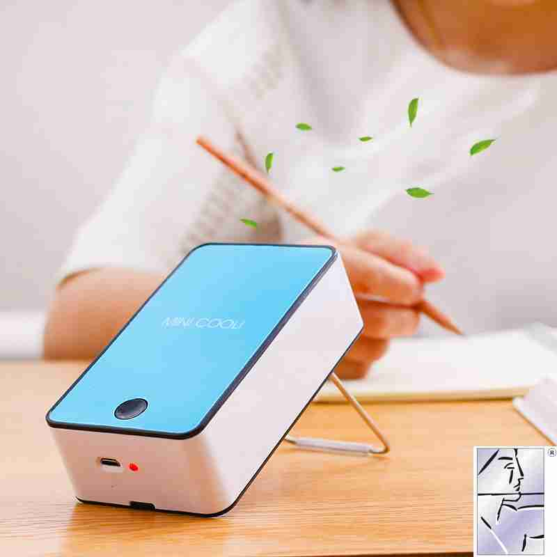 A new mini fan refrigeration and air conditioning USB charging portable office desk mute student dormitory