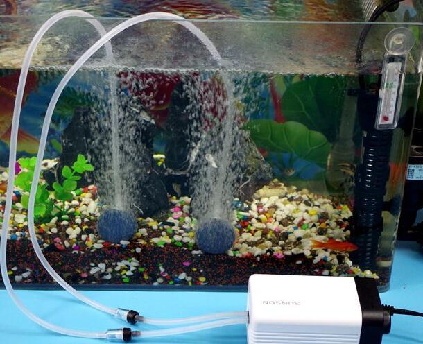 El acuario de una bomba de oxígeno de pecera oxigenada goldfish mudo pequeñas mini hogar aumento a bomba de oxígeno