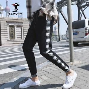 啄木鸟新款秋季青年修身潮男小脚牛仔裤