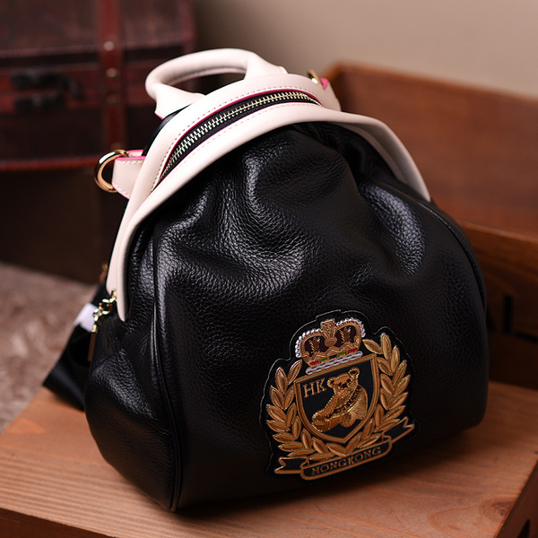 2017 spring and summer new head layer leather shoulder bag female Korean version of the wave of leather leather backpack bear pattern female package