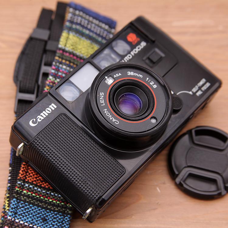 129H Canon A35m máy ảnh cũ 135 phim bộ phim cổ điển máy 38 2.8 ống kính rangefinder máy ảnh