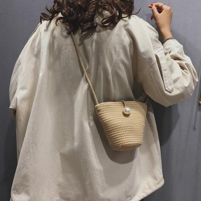 夏天高级感水桶包包女包新款洋气单肩草编包斜挎包手工编织包