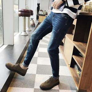 男士秋冬新款牛仔长裤韩版潮弹力小脚裤休闲修身型青少年学生牛仔