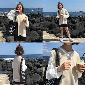 Mùa thu và mùa đông phụ nữ Hàn Quốc phiên bản của trường gió lỏng màu phù hợp với v-cổ dài tay dệt kim vest áo len vest sinh viên