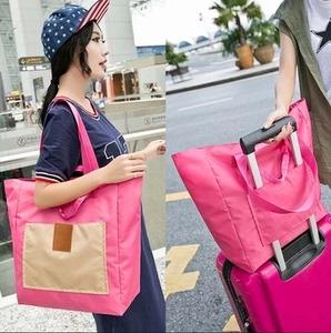 Gấp túi du lịch hành lý xách tay nữ công suất lớn nội trú túi du lịch ngắn túi nam không thấm nước có thể được đặt xe đẩy trường hợp